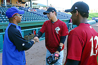 April 28, 2009: Infield prospects Wilmer Flores, center, and Jefry Marte, right, of the Savannah Sand Gnats, Class A affiliate of the New York Mets, talk with roving instructor Kevin Morgan prior to a game against the Greenville Drive at Fluor Field at the West End in Greenville, S.C. Photo by: Tom Priddy/Four Seam Images