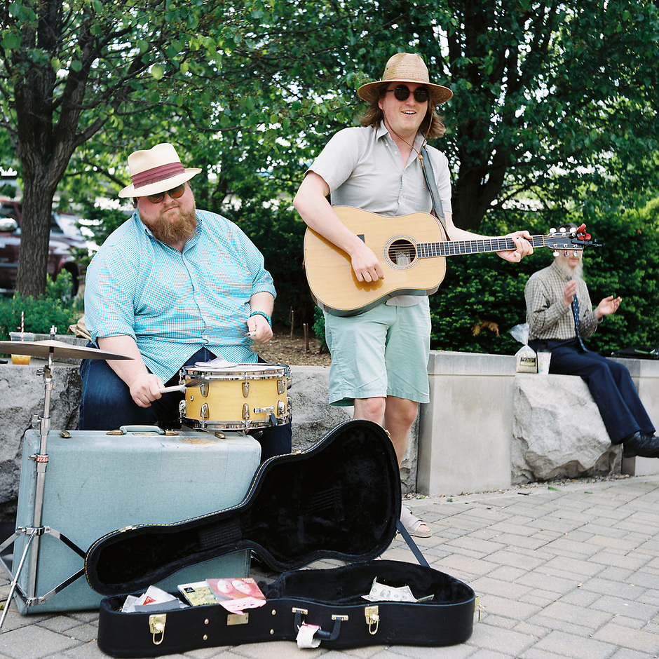 Addison Rogers, left, and Lewis Rogers of Busman's Holiday perform at the Bloomington Farmer's Market in Bloomington, Indiana on Saturday, May 12, 2018. (Photo by James Brosher)