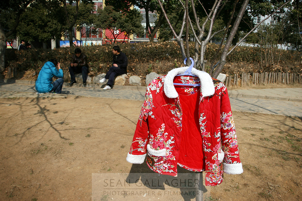 CHINA. Jiangxi Province. Jiujiang. A jacket hanging out to dry in a park. Jiujiang is a city of 4.6 million people, located on the southern shore of the Yangtze River.  2008