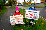 Aoibheann O'Donnell and Nicholas O'Shea supporting their moms on the 200th day on the picket line in Debenhams Tralee on Monday.
