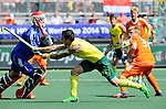 The Hague, Netherlands, June 15: Kieran Govers #27 of Australia tries to score during the field hockey gold match (Men) between Australia and The Netherlands on June 15, 2014 during the World Cup 2014 at Kyocera Stadium in The Hague, Netherlands. Final score 6-1 (2-1)  (Photo by Dirk Markgraf / www.265-images.com) *** Local caption *** Jaap Stockmann #1 of The Netherlands, Kieran Govers #27 of Australia, Mink van der Weerden #30 of The Netherlands