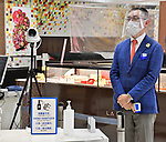 Employees wearing face shields and face masks are seen at the Matsuya Ginza department store in Tokyo, Japan on May 25, 2020. (Photo by AFLO)