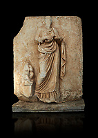 Roman Sebasteion relief  sculpture of Hygieia, Aphrodisias Museum, Aphrodisias, Turkey.   Against a black background.<br /> <br /> Hygieia, the goddess of Health, hold a flat bowl (phiale) from which she feeds a snake. The snake is wound twice around her forearm. A plump naked child sits on a square pedestal. Hygieia was the daughter of the healing god Asklepios, with whom she is paired here