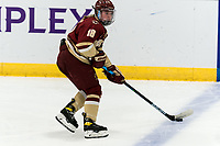 WORCESTER, MA - JANUARY 16: Kelly Browne #18 of Boston College looks to pass during a game between Boston College and Holy Cross at Hart Center Rink on January 16, 2021 in Worcester, Massachusetts.