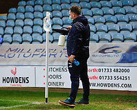A member of Peterborough United ground staff uses a disinfectant spay to sanitise the corner flag during half-time as part of Covid-19 safety precautions <br /> <br /> Photographer Chris Vaughan/CameraSport<br /> <br /> The EFL Sky Bet League One - Peterborough United v Blackpool - Saturday 21st November 2020 - London Road Stadium - Peterborough<br /> <br /> World Copyright © 2020 CameraSport. All rights reserved. 43 Linden Ave. Countesthorpe. Leicester. England. LE8 5PG - Tel: +44 (0) 116 277 4147 - admin@camerasport.com - www.camerasport.com