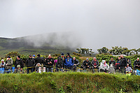 Fans wait patiently as another session is cancelled due to bat weather as the cloud comes in over the Mountain behind them at the Gooseneck during the 2019 Isle of Man TT (Tourist Trophy) Races, Fuelled by Monster Energy DOUGLAS, ISLE OF MAN - June 05. Photo by David Horn.