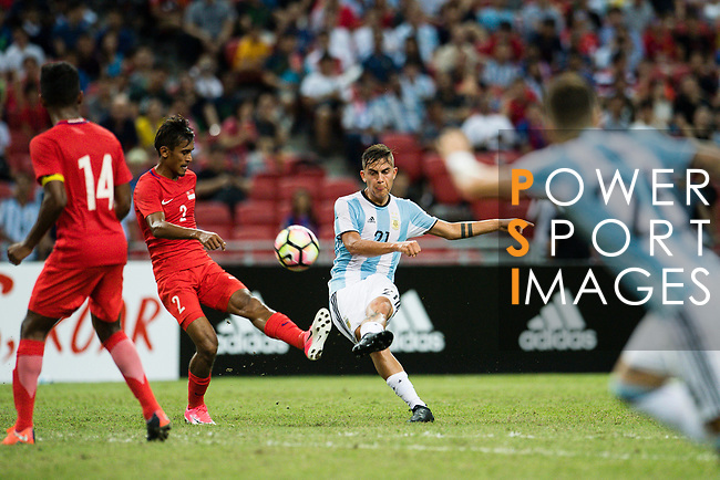 Paulo Dybala of Argentina (R) looks to bring the ball down during the International Test match between Argentina and Singapore at National Stadium on June 13, 2017 in Singapore. Photo by Marcio Rodrigo Machado / Power Sport Images
