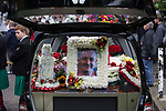"""© Joel Goodman - 07973 332324 . 28/08/2015 . Salford , UK . A portrait of Paul Massey on one of the hearses . The funeral of Paul Massey at St Paul's CE Church in Salford . Massey , known as Salford's """" Mr Big """" , was shot dead at his home in Salford last month . Photo credit : Joel Goodman"""