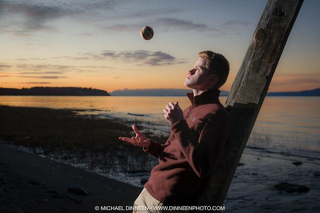 Senior Portrait for Trevor Houghton along Coastal Trail at sunset