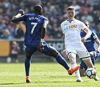 (L-R) Yannick Bolasie of Everton challenged by Alfie Mawson of Swansea City during the Premier League match between Swansea City and Everton at The Liberty Stadium, Swansea, Wales, UK. Saturday 14 April 2018