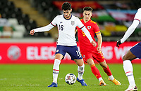 SWANSEA, WALES - NOVEMBER 12: Johnny #16 of the United States turns with the ball during a game between Wales and USMNT at Liberty Stadium on November 12, 2020 in Swansea, Wales.