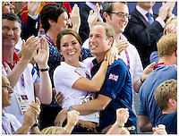 01,08,2012  Picture by Tim Clarke.Kate and William embrace after watching British cyclists Sir Chris Hoy, Jason Kenny(middle) and Philip Hindes(left) rwin  the team sprint