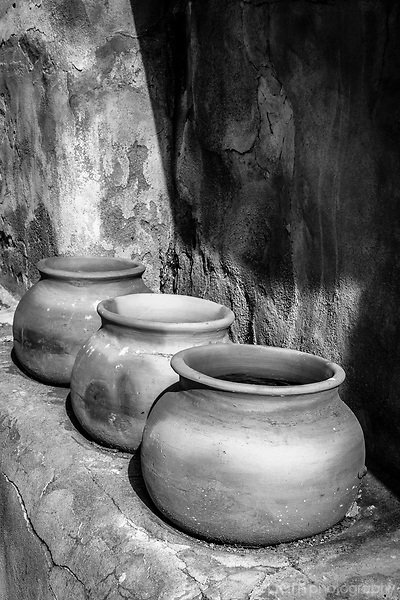 Black and white image of three pots in old Mission kitchen