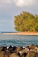 Couple viewing sunst at Kee beach. Kauai, Hawaii