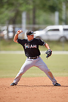 Miami Marlins second baseman Mike Garzillo (26) throws to first base during a minor league Spring Training game against the New York Mets on March 26, 2017 at the Roger Dean Stadium Complex in Jupiter, Florida.  (Mike Janes/Four Seam Images)