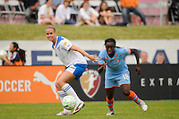 Leslie Osborne (12) of the Boston Breakers and Eniola Aluko (18) of Sky Blue FC. Sky Blue FC and the Boston Breakers played to a 0-0 tie during a Women's Professional Soccer (WPS) match at Yurcak Field in Piscataway, NJ, on June 12, 2011.