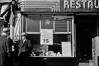 75¢ Thanksgiving: On a main street in Norwich, Connecticut. November 1940.