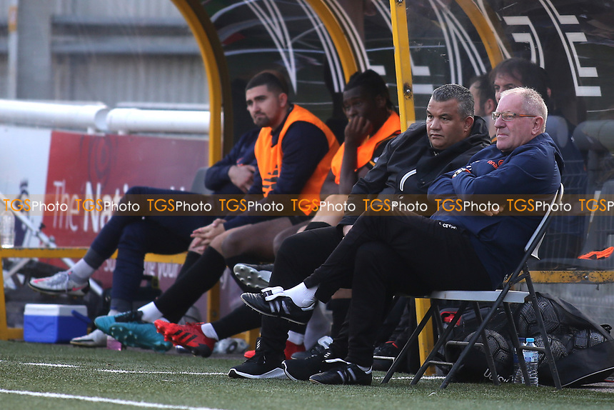 Maidstone United Assistant Manager, Terry Harris (far right) watches the game alongside, Maidstone United Manager, Hakan Hayrettin during Maidstone United vs Eastbourne Borough, Vanarama National League South Football at the Gallagher Stadium on 9th October 2021