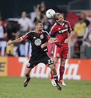 D.C. United midfielder Perry Kitchen (23) heads   the ball against Chicago Fire forward Chris Rolfe (18) D.C. United defeated The Chicago Fire 4-2 at RFK Stadium, Wednesday August 22, 2012.