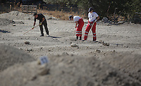 Pictured: Forensics officers and Hellenic Red Cross volunteers sift through soil in Kos, Greece. Wednesday 05 October 2016<br />Re: Police teams led by South Yorkshire Police, searching for missing toddler Ben Needham on the Greek island of Kos have moved to a new area in the field they are searching.<br />Ben, from Sheffield, was 21 months old when he disappeared on 24 July 1991 during a family holiday.<br />Digging has begun at a new site after a fresh line of inquiry suggested he could have been crushed by a digger.
