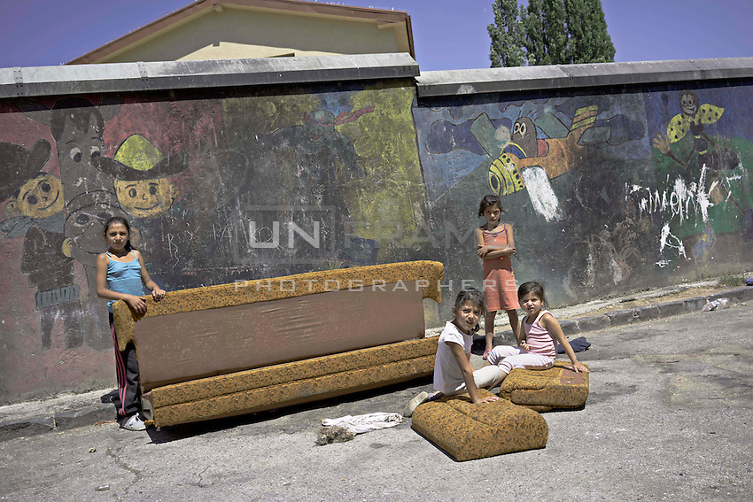"""Lunik IX is now home to five thousand Roma, since 2011 the local government have demolished five blocks subsequently living Roma inhabitant now where to live. Children playing """"House""""."""