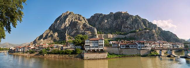 Ottoman villas of Amasya along the banks of the river Yesilırmak , below the Pontic Royal rock tombs and mountain top ancient citadel, Turkey