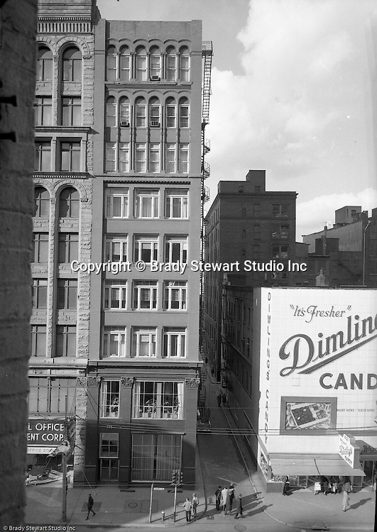 Pittsburgh PA:  View of the Gamble Building at 725 Liberty Avenue and Dimling's Candies in Pittsburgh.  Brady Stewart Studio occupied the entire 4th flood of the building.  The space was perfect for a commercial photography studio with 20 ft ceilings and room for 2 darkrooms, 2 large sets up areas.<br /> <br /> Dimling's Candies had a number of retail stores throughout Pittsburgh during the 1950s and 1960s.  And the success forces its major competitor Reymer Brothers to sell out to HJ Heinz in 1960.