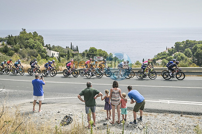The breakaway passes by during Stage 10 of La Vuelta d'Espana 2021, running 189km from Roquetas de Mar to Rincón de la Victoria, Spain. 24th August 2021.     <br /> Picture: Charly Lopez/Unipublic | Cyclefile<br /> <br /> All photos usage must carry mandatory copyright credit (© Cyclefile | Unipublic/Charly Lopez)