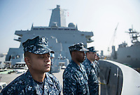 130422-N-DR144-269 SAN DIEGO (April 22, 2013) Boatswain's Mate 2nd Class Warren Kitogo and other Sailors assigned to the sea and anchor detail come to attention after taking in mooring lines as Amphibious Transport Dock Ship USS Anchorage (LPD 23) gets underway from its homeport of San Diego. Anchorage is en route to its namesake city of Anchorage, Alaska for its commissioning ceremony, scheduled to take place May 4. (U.S. Navy photo by Mass Communication Specialist 1st Class James R. Evans / RELEASED)