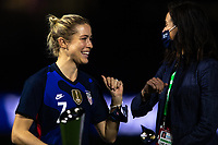 ORLANDO CITY, FL - FEBRUARY 24: Abby Dahlkemper #7 of the USWNT picks up her medal during a game between Argentina and USWNT at Exploria Stadium on February 24, 2021 in Orlando City, Florida.