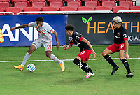 WASHINGTON, DC - SEPTEMBER 12: Kyle Duncan #6 of the New York Red Bulls is defended by Kevin Paredes #30 of D.C. United during a game between New York Red Bulls and D.C. United at Audi Field on September 12, 2020 in Washington, DC.