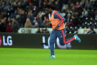 Bafetimbi Gomis of Swansea warms up during half time during the Barclays Premier League match between Swansea City and West Bromwich Albion played at the Liberty Stadium, Swansea on December 26 2015