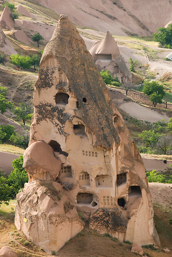 One of the thousands of cave dwellings in Cappadocia. With the outer layers of rock now washed away by erosion, one can see the honeycombed structure of tunnels and rooms that likely held a small village. The easily carvable rock, called tufa, was home to over 3000 cave homes, churches and monasteries.