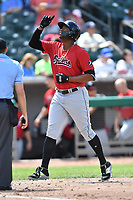 Birmingham Barons left fielder Eloy Jimenez (21) gives thanks after hitting a home run during a game against the Tennessee Smokies at Smokies Stadium on May 6, 2018 in Kodak, Tennessee. The Smokies defeated the Barons 6-2. (Tony Farlow/Four Seam Images)