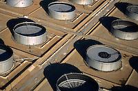 Oil tanks in landscape.