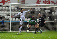 Pictured: Kenji Gorre of Swansea (L) fails to score from a team mate's cross Monday 30 March 2015<br />