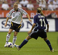 Argentina midfielder (11) Rosana Gomez defends Germany defender (2) Kerstin Stegemann. Germany (GER) defeated Argentina (ARG) 11-0 during an opening round Group A match of the FIFA Women's World Cup China 2007 at Shanghai Kongkou Football Stadium, Shanghai, China, on September 10, 2007.