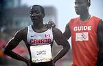 George Quarcoo and Adam Johnson, Toronto 2015 - Para Athletics // Para-athlétisme.<br /> George Quarcoo and his guide Adam Johnson compete in the Men's 100m T12 semifinal // George Quarcoo et son guide Adam Johnson participent à la demi-finale du 100 m T12 masculin. 10/08/2015.