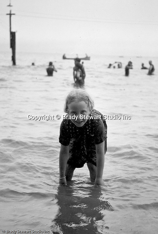 Lake Erie PA:  Little girl playing in the waves on Lake Erie.