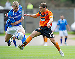 St Johnstone v Dundee United...27.08.11   SPL Week 5.John Rankin tackles Jamie Adams.Picture by Graeme Hart..Copyright Perthshire Picture Agency.Tel: 01738 623350  Mobile: 07990 594431