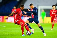 13th April 2021; Parc de Princes, Paris, France; UEFA Champions League football, quarter-final; Paris Saint Germain versus Bayern Munich;  Kylian Mbappe (PSG) takes on Jerome Boateng (Bayern)