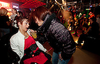 Personal assistant, Liz, brings Kara a mixed drink on the dance floor at Trexx, an alternative lifestyle dance club in downtown Syracuse where she feels comfortable being herself.  Photo by James R. Evans ©