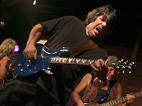 Slick Aguilar, lead guitar, rocks as Jefferson Starship performs  two shows at the Acorn Theater, Three Oaks, MI, Thursday, July 30, 2009. They are beginning a 40th Anniversary of Woodstock tour.