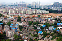 Old buildings and houses in the foreground contrasts with new apartment blocks in the background. /Felix Features