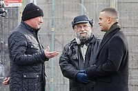 Pictured: John Brandler (C) with Ian Lewis (L) and a camera crew from BBC's The One Show in Port Talbot. Friday 01 February 2019<br /> Re: Gallery owner and art collector John Brandler meets with garage owner Ian Lewis, where Banksy created his latest graffiti in Port Talbot, Wales, UK.