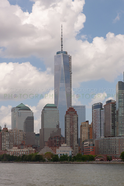 The Freedom Tower (One World Trade Center) rises over Battery Park City and the Hudson River in New York City.