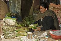 Kathmandu, Nepal.  Market vendor lady selling saal leaf bowls for temple food offerings.