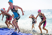 16 SEP 2012 - NICE, FRA - Non Stanford (second from left in light blue and dark blue) of TCG 79 Parthenay runs up the beach at the end of the swim during the final stage of the French Grand Prix triathlon series held during the Triathlon de Nice Côte d'Azur .(PHOTO (C) 2012 NIGEL FARROW)