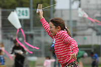 Eva Stevenson flies her kie on the OB Elementary Playground during the 60th annual Ocean Beach Kite Festival, Craft Fair and Parade on Saturday, March 1, 2008.