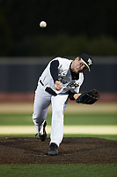 Wake Forest Demon Deacons relief pitcher Shane Smith (21) delivers a pitch to the plate against the Louisville Cardinals at David F. Couch Ballpark on March 7, 2020 in  Winston-Salem, North Carolina. The Demon Deacons defeated the Cardinals 3-2. (Brian Westerholt/Four Seam Images)